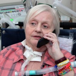 Patient with PMV007 inline talking on a cellphone